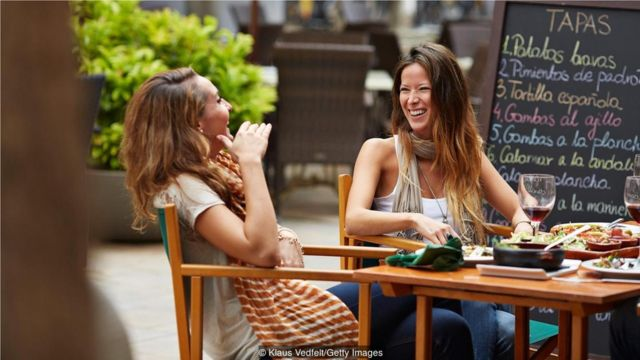 In Spain, the purpose of going out for lunch is catching up with friends or family (Credit: Klaus Vedfelt/Getty Images)
