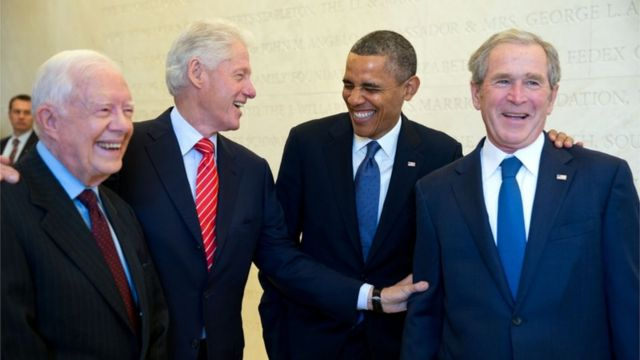 Presidents Carter, Clinton, Obama and Bush wait backstage to be introduced during the dedication of the George W. Bush Presidential Library and Museum