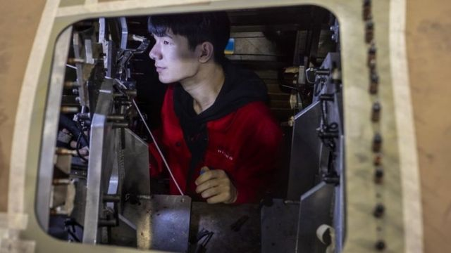 Chinese factory worker in plane factory in China