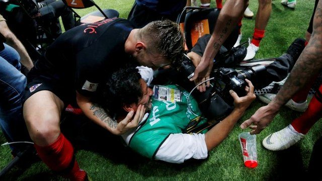 Croatian players celebrate with a photographer