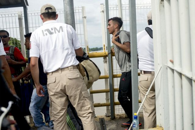 A migrant enters Mexico at the border with Guatemala.