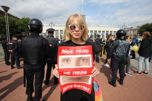 """Demonstrator in St Petersburg - the sign says, """"My body is not a battlefield"""""""