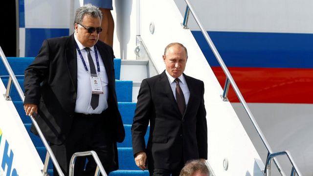राष्ट्रपति व्लादिमीर पुतिन के साथ एंड्रे कार्लोफ़