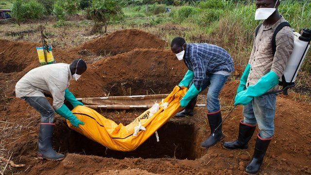 A victim of Ebola is buried in Sierra Leone in 2014