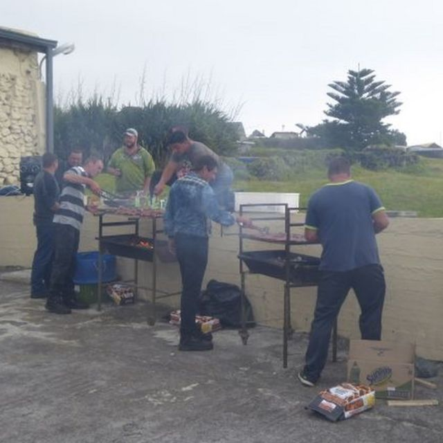 Men with barbeques