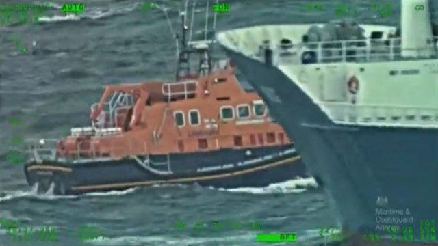 Cargo ship and coastguard vessel