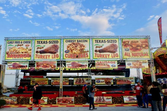 A stand advertising different variations of Turkey legs