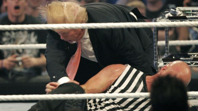 Donald Trump gets taken to the mat by 'Stone Cold' Steve Austin after the the Battle of the Billionaires at the 2007 World Wrestling Entertainment's Wrestlemania April 1, 2007 at Ford Field in Detroit, Michigan.