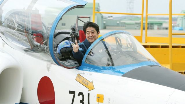 Shinzo Abe in a jet cockpit