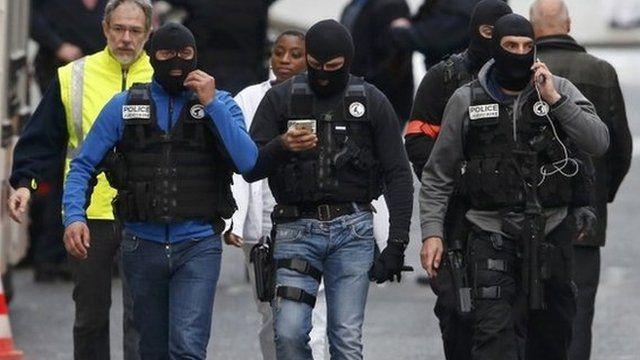 Masked police in Saint Denis