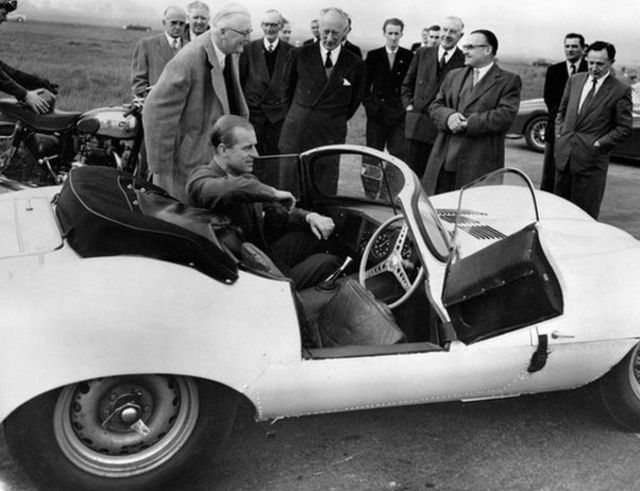 The Duke of Edinburgh is seen trying the passenger's seat of the new 3.5 litre Jaguar XKSS sports car during his visit to the Motor Industry Research Association's headquarters near Nuneaton, Warwickshire / Copyright: PA