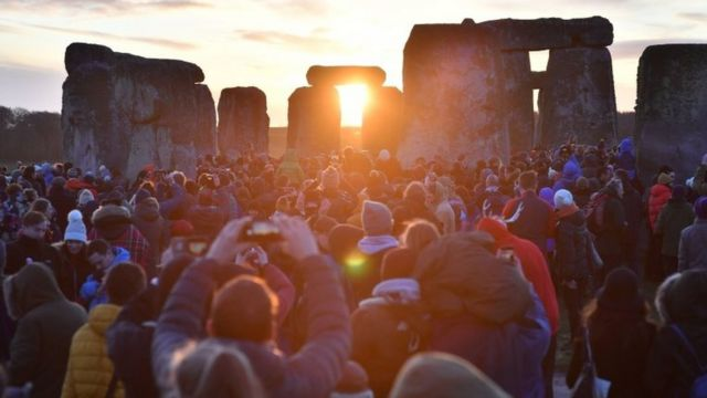People gather at Stonehenge in Wiltshire to mark the winter solstice, and to witness the sunrise after the longest night of the year. PA Photo. Picture date: Sunday December 22, 2019.