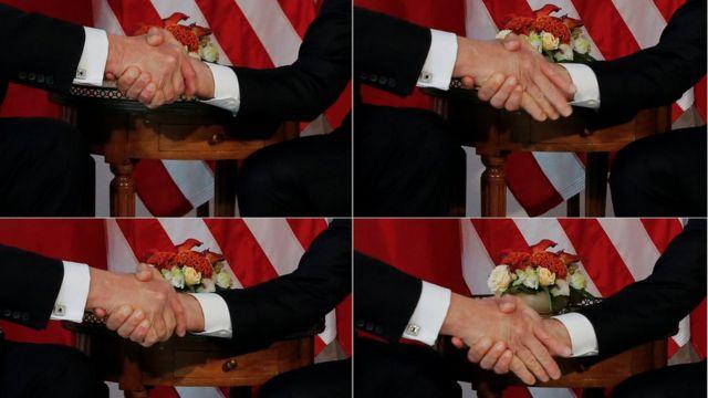 Макрон (справа) довольно долго не отпускал руку Трампа