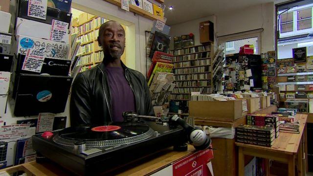 Don Cheadle in a record shop