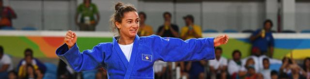 Majlinda Kelmendi of Kosovo celebrates winning the gold medal against Odette Giuffrida of Italy during the WomenÂ's -52kg gold medal final on Day 2 of the Rio 2016 Olympic Games