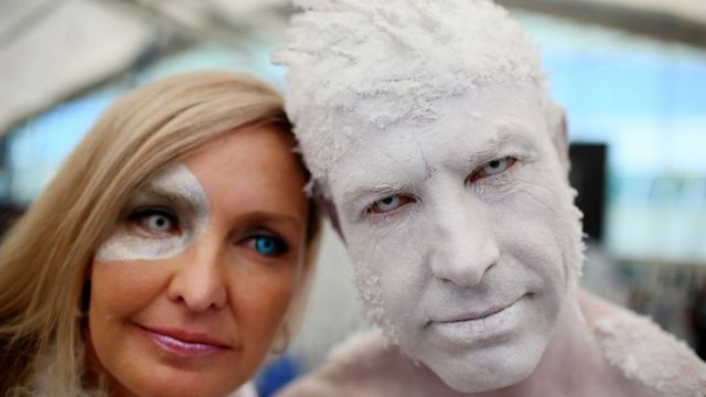 Todd Schmidt (r) and his wife, (name not given) dressed as the Iceman at the San Diego Convention Center during Comic Con International on July 20, 2017 in San Diego