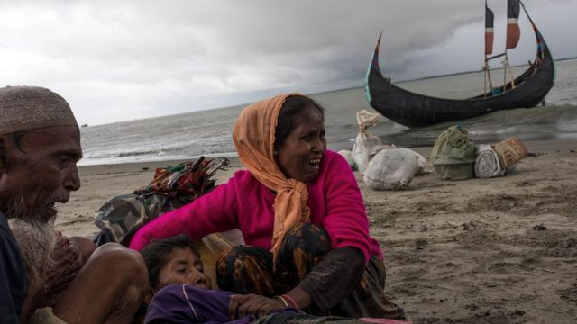 Rohingya refugees comfort an elderly woman, after the wooden boat they were travelling on from Myanmar, crashed into the shore and tipped everyone out on September 12, 2017 in Dakhinpara, Bangladesh.