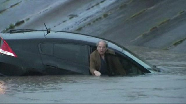 A man trapped in his car during flash floods in Texas.