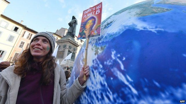 Woman holding poster reading 'There is no Planet B'