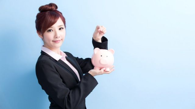 Japanese woman with piggybank