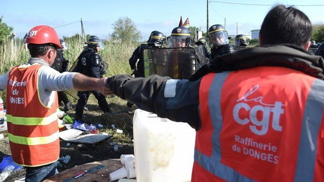 French union strikers and riot police