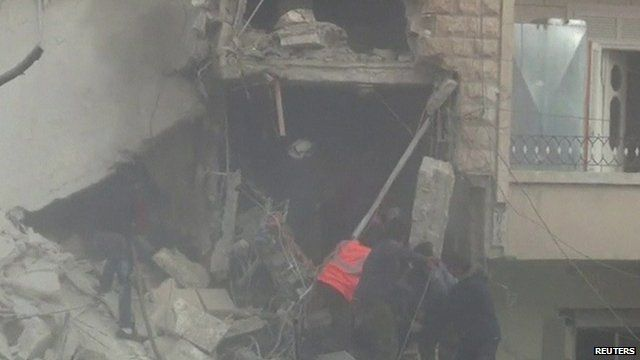 Rescue workers search for survivors in a collapsed building