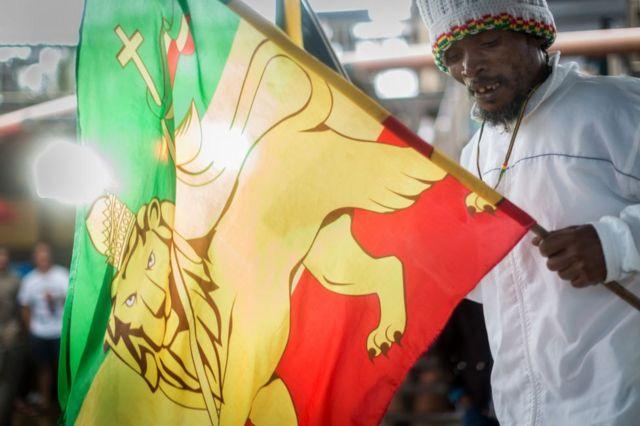 Rastafarian Reggae fans gather at the start of the Bob Marley Earthday Festival and Rasta Fair at the South Beach in Durban, on February 3, 2018.