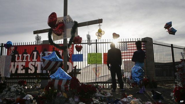 People pay respects at a makeshift memorial honouring the victims of the San Bernardino attack