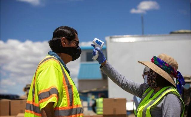Navajo Nation President Jonathan Nez has his temperature checked