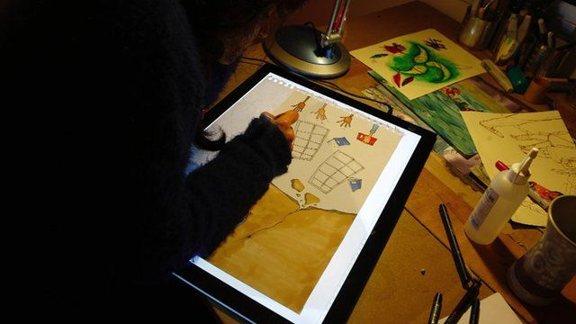Artist Diala Brisly at work
