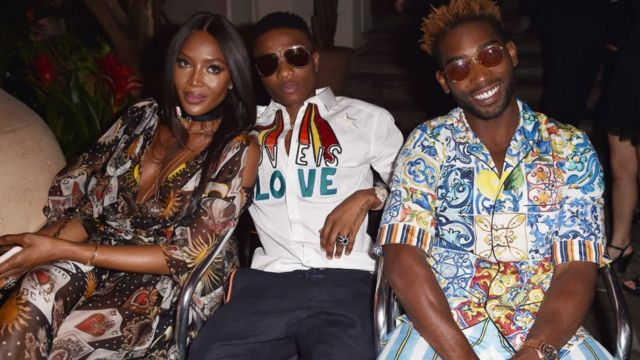 (L-R) Naomi Campbell, Wiz Kid and Tinie Tempah attend Dolce & Gabbana Naked King secret show for Milan Men Fashion Week