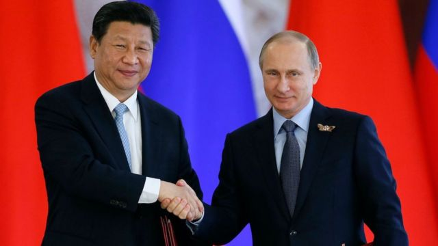 Russian President Vladimir Putin and Chinese President Xi Jinping shake hands after signing a document after their talks in the Kremlin in Moscow, Russia, 09 May 2015.