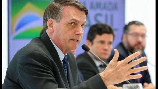 Bolsonaro, com Moro ao fundo, na reunião de 22 de abril