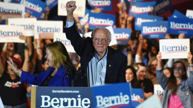 Bernie Sanders lifts his fist at a campaign rally in San Antonio, Texas