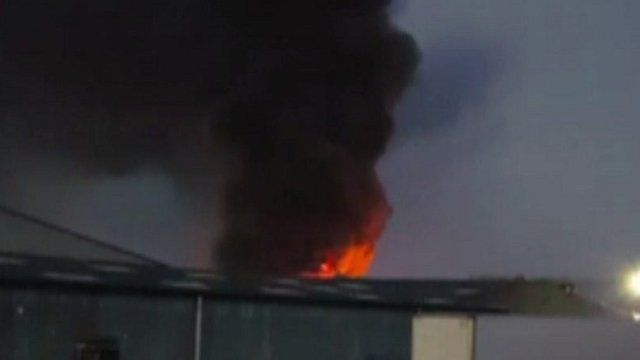 Fire burns at factory