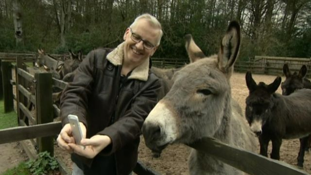 Chris Clarke takes a selfie with a donkey