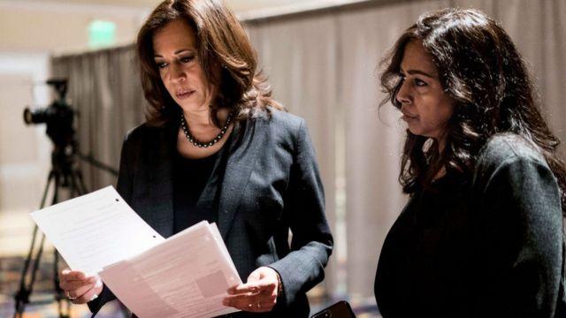 Senator Kamala Harris, with sister and advisor Maya Lakshmi Harris, prepares to speak at a 2019 event