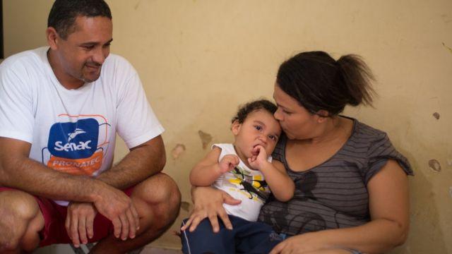 João Miguel com os pais