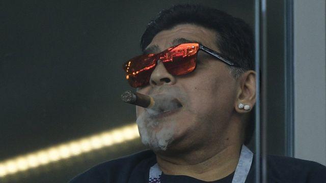 Diego Maradona smoking a cigar