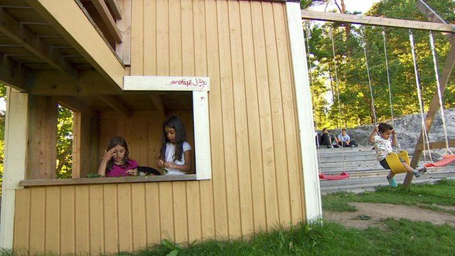 Children playing inside one of Sweden's immigration camps