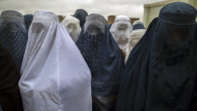Afghan women wait to cast their ballot at a polling station in Mazar-i-sharif April 5, 2014.