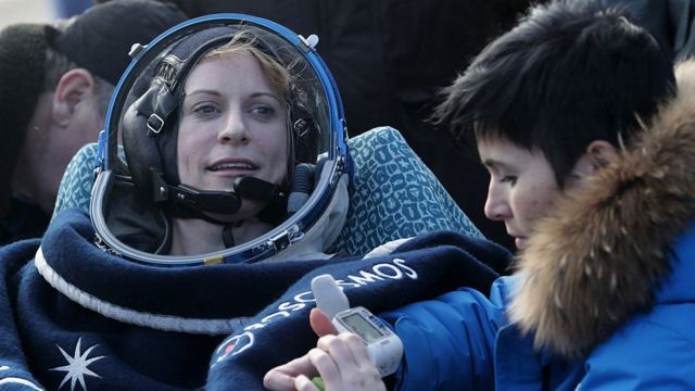 US astronaut Kate Rubins rests in a chair outside the Soyuz MS space capsule after she and two other astronauts landed in a remote area about 150 kms (90 miles) southeast of the Kazakh town of Dzhezkazgan.