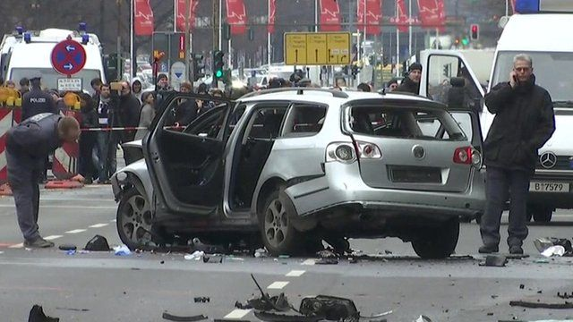 German police inspect an exploded car in Berlin.