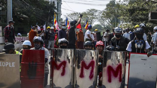 Demonstrators carried shields as they prepared for clashes with Myanmar armed forces during a protest against the military coup in Mandalay, Myanmar, 07 March 2021