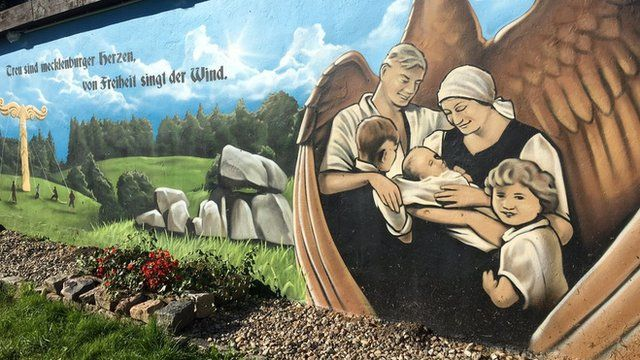 Mural of family in Jamel