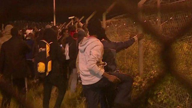 Men attempt to break through fence