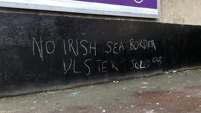 Graffiti against the border of the Irish Sea