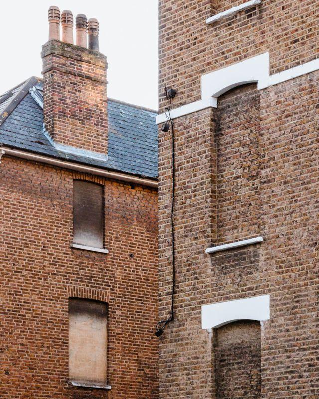 Bricked-up windows on Hazlitt Road, London