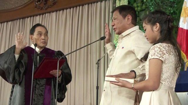 Rodrigo Duterte (centre) is sworn in as president of the Philippines