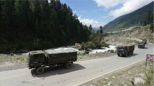 Indian army vehicles move along a highway leading to Ladakh, at Gagangeer some 81 kilometers from Srinagar, the summer capital of Indian Kashmir, 01 September 2020.